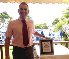 The Hotel Manager of Inturotel Cala Azul Park poses with the Traveller Choice Award