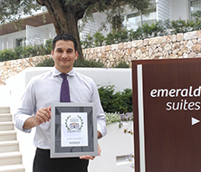 The Hotel Manager of Inturotel Cala Esmeralda poses with the Traveller Choice Award